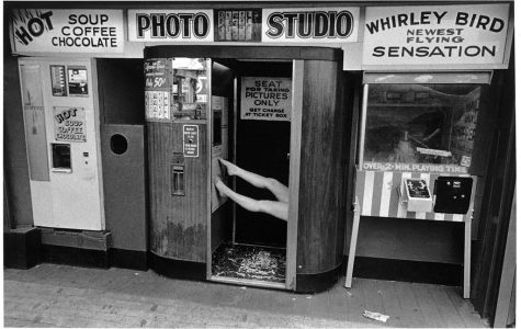 Legs in Photo Booth, Coney Island, 1974 - Photo by Harvey Stein