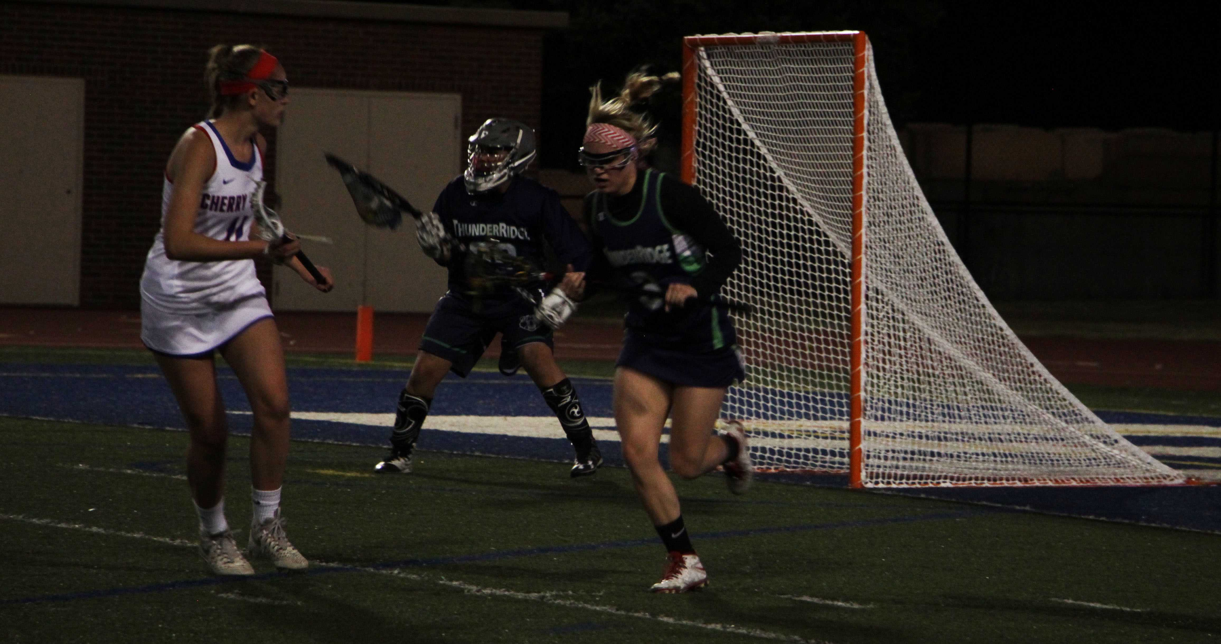 PHOTOS: First Varsity Girls Lacrosse Game