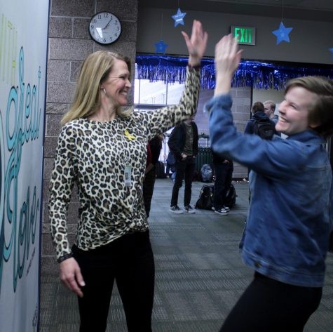Science teacher Jennifer Haskell high-fives junior Paige Gerling.